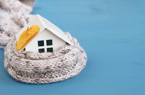 Small decorative house wrapped in sweater